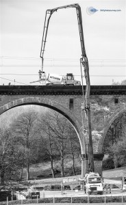 Transformer like concrete pumping upto viaduct deck during major engineering work by Network Rail on the Holmes Chapel viaduct near Crewe